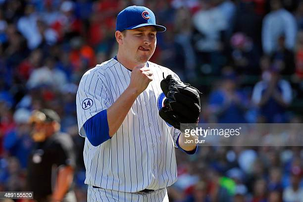 Trevor Cahill of the Chicago Cubs celebrates after striking out Jhonny Peralta of the St Louis Cardinals to end the fifth inning at Wrigley Field on...