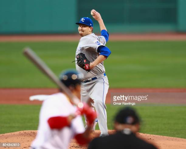 Trevor Cahill of the Kansas City Royals pitches to Mookie Betts of the Boston Red Sox in the bottom of the first inning during the game against the...