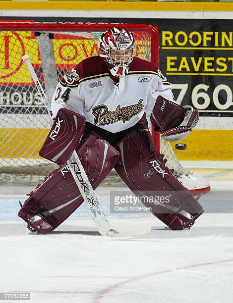 Trevor Cann of the Peterborough Petes keeps his eye on the incoming puck in a game against the London Knights on November 1 2007 at the Peterborough...