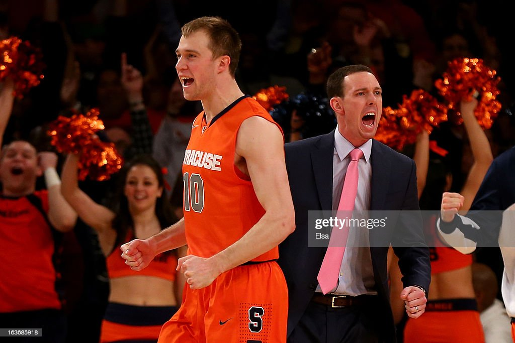 Trevor Cooney #10 and assistant coach Gerry McNamara of the Syracuse Orange react after C.J. Fair #5 made a 3-point basket at the buzzer of the end of the first half against the Pittsburgh Panthers during the quaterfinals of the Big East Men's Basketball Tournament at Madison Square Garden on March 14, 2013 in New York City.