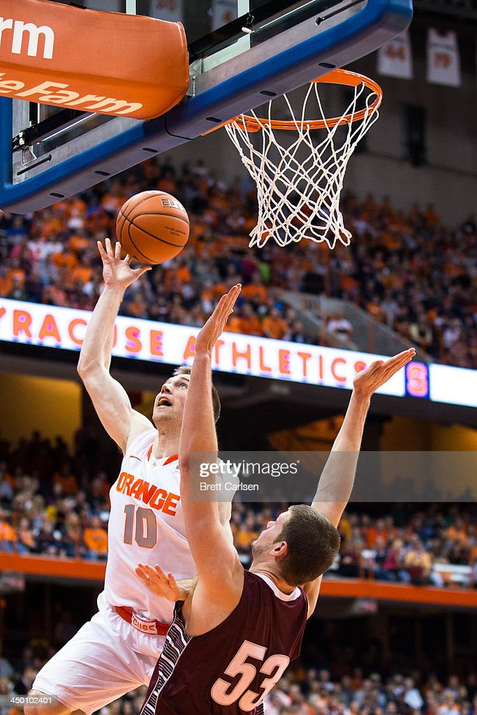 Trevor Cooney #10 of Syracuse Orange goes up against Ethan Jacobs #53 of Colgate Raiders and misses during the second half of a basketball game on November 16, 2013 at the Carrier Dome in Syracuse, New York. Syracuse defeated Colgate 69-50.