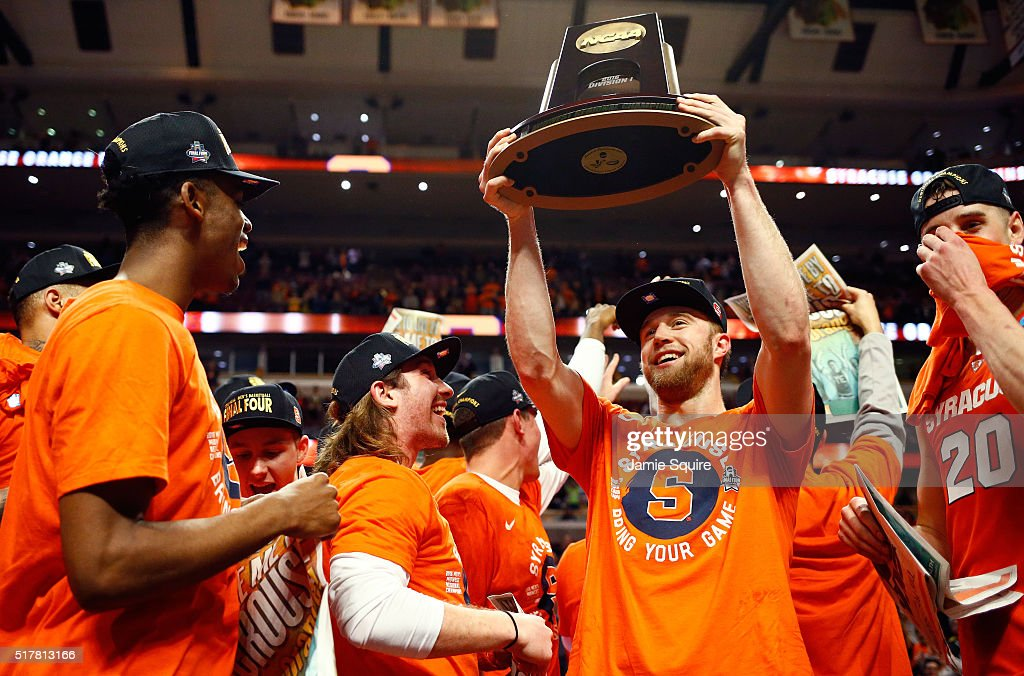 Trevor Cooney of the Syracuse Orange celebrates their 68 to 62 win over the Virginia Cavaliers with teammates during the 2016 NCAA Men's Basketball...