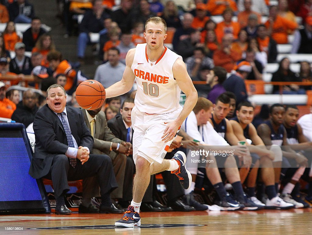 Trevor Cooney #10 of the Syracuse Orange drives the ball down the court during the game against the Monmouth Hawks at the Carrier Dome on December 8, 2012 in Syracuse, New York.