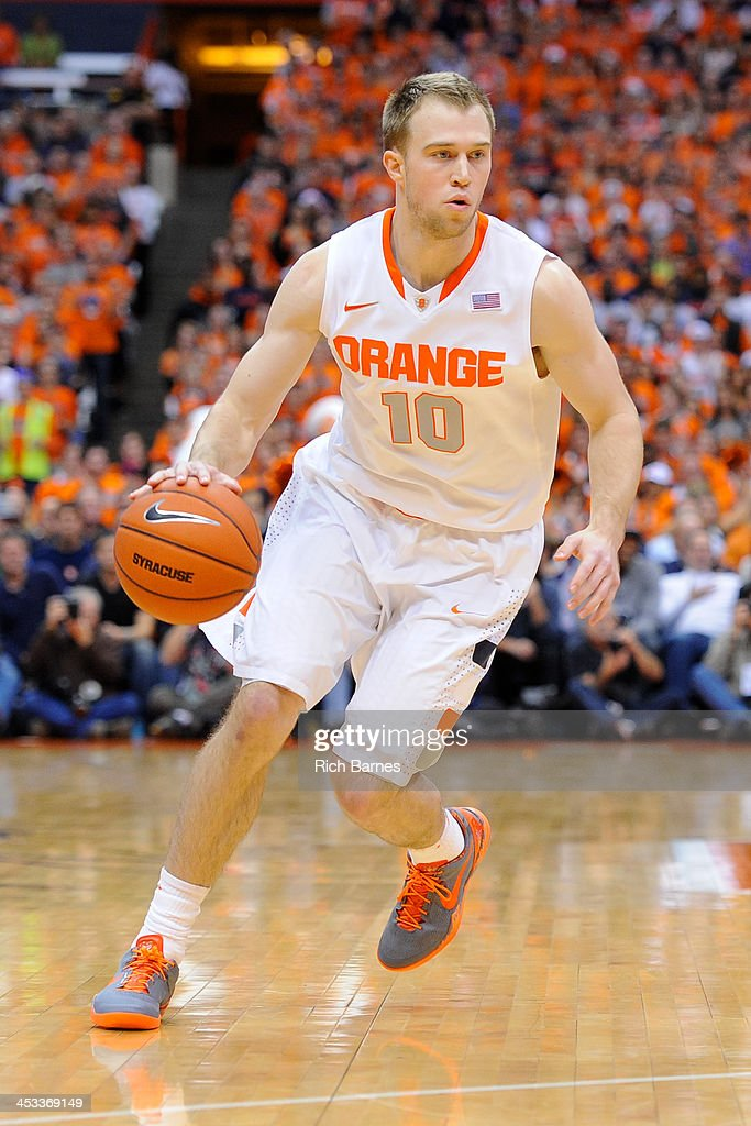 Trevor Cooney #10 of the Syracuse Orange drives to the basket against the Indiana Hoosiers during the first half at the Carrier Dome on December 3, 2013 in Syracuse, New York. Syracuse defeated Indiana 69-52.