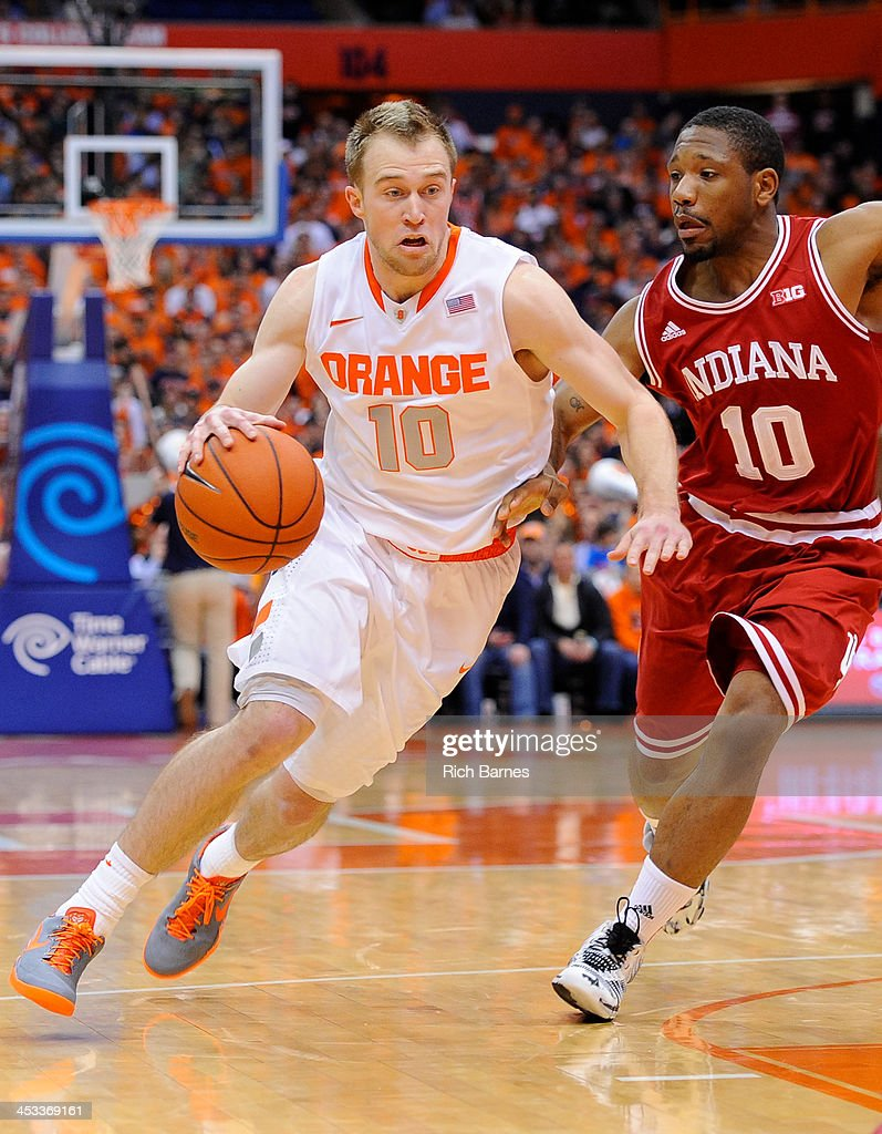 Trevor Cooney #10 of the Syracuse Orange drives to the basket past Evan Gordon #10 of the Indiana Hoosiers during the first half at the Carrier Dome on December 3, 2013 in Syracuse, New York. Syracuse defeated Indiana 69-52.