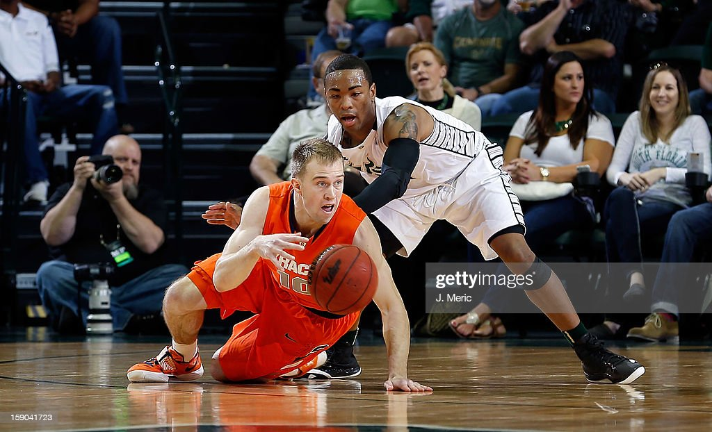 Trevor Cooney #10 of the Syracuse Orange drops the ball as Anthony Collins #11 of the South Florida Bulls defends during the game at the Sun Dome on January 6, 2013 in Tampa, Florida.