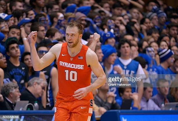 Trevor Cooney of the Syracuse Orange flashes the 'show me the money' gesture after making a threepoint shot against the Duke Blue Devils during their...