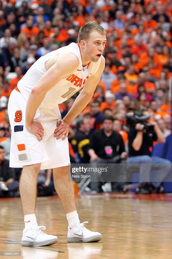 Trevor Cooney #10 of the Syracuse Orange looks on from the court during a break in play in the game against the Villanova Wildcats at the Carrier Dome on January 12, 2013 in Syracuse, New York.