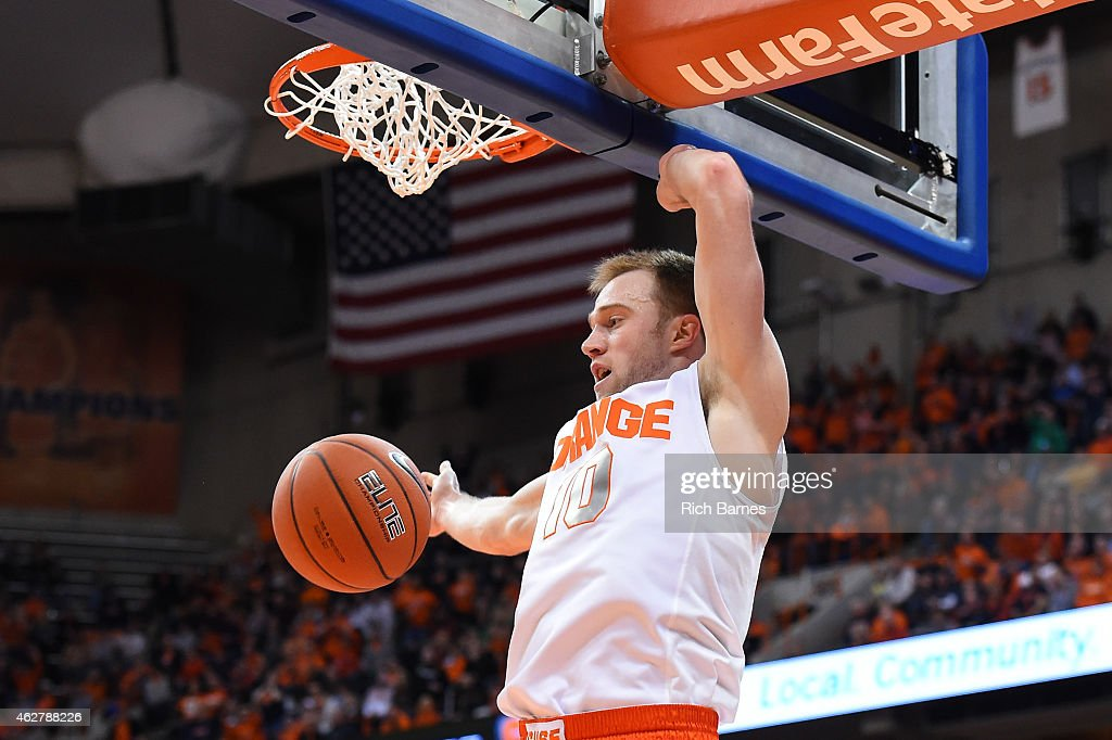 <a gi-track='captionPersonalityLinkClicked' href=/galleries/search?phrase=Trevor+Cooney&family=editorial&specificpeople=7117579 ng-click='$event.stopPropagation()'>Trevor Cooney</a> #10 of the Syracuse Orange reacts after dunking the ball against the Virginia Tech Hokies during the first half at the Carrier Dome on February 3, 2015 in Syracuse, New York. Syracuse defeated Virginia Tech 72-70.