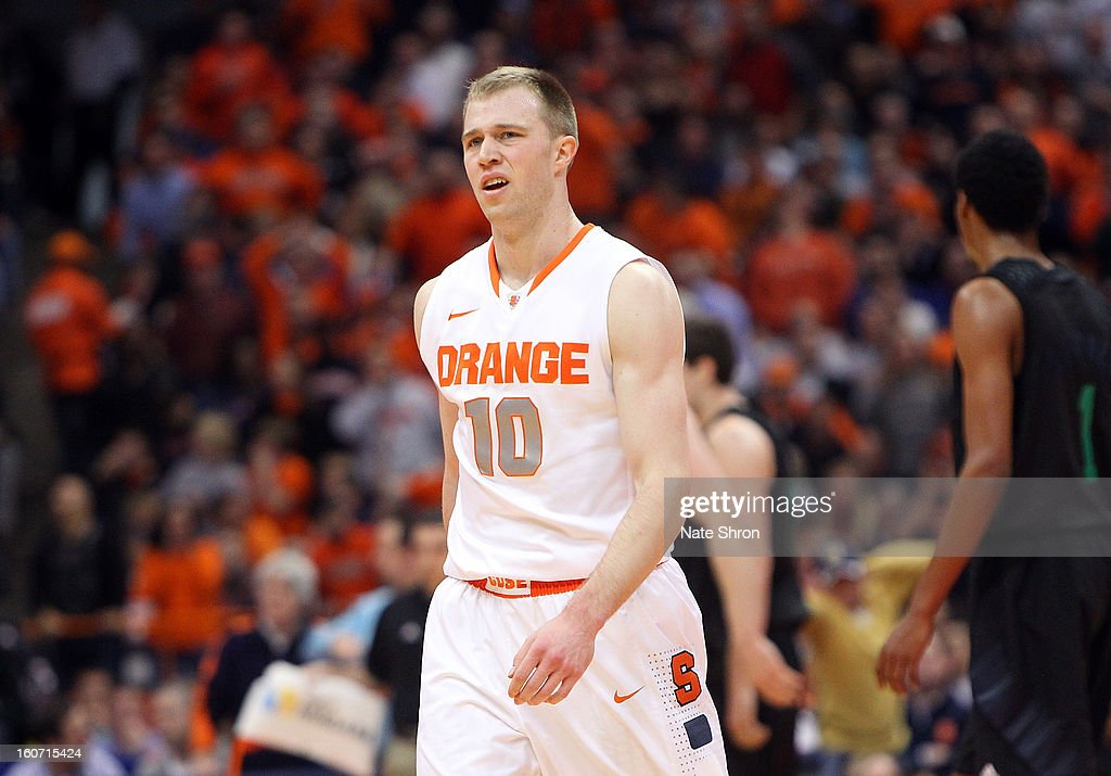 Trevor Cooney #10 of the Syracuse Orange reacts as he walks off the court after a play against the Notre Dame Fighting Irish at the Carrier Dome on February 4, 2013 in Syracuse, New York.