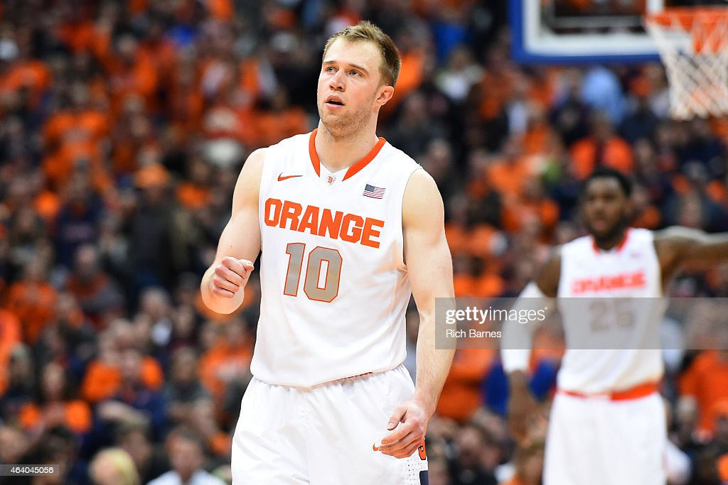 <a gi-track='captionPersonalityLinkClicked' href=/galleries/search?phrase=Trevor+Cooney&family=editorial&specificpeople=7117579 ng-click='$event.stopPropagation()'>Trevor Cooney</a> #10 of the Syracuse Orange reacts to a made basket against the Louisville Cardinals during the second half at the Carrier Dome on February 18, 2015 in Syracuse, New York. Syracuse defeated Louisville 69-59.
