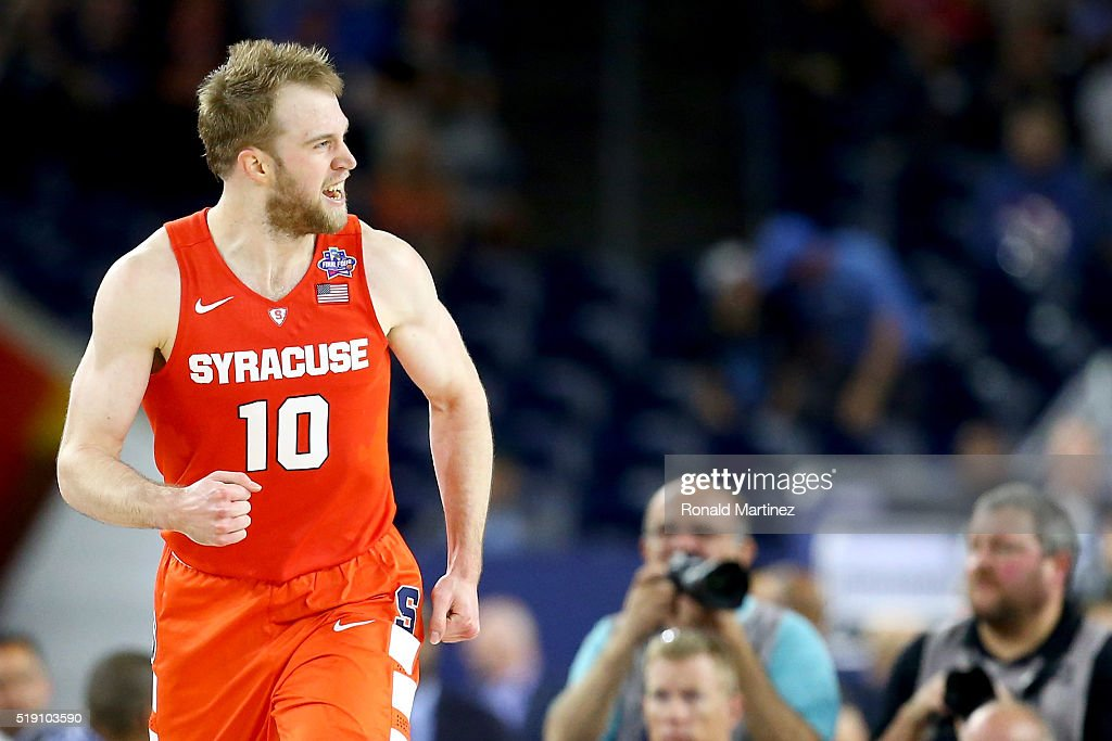 <a gi-track='captionPersonalityLinkClicked' href=/galleries/search?phrase=Trevor+Cooney&family=editorial&specificpeople=7117579 ng-click='$event.stopPropagation()'>Trevor Cooney</a> #10 of the Syracuse Orange reacts while taking on the North Carolina Tar Heels during the NCAA Men's Final Four Semifinal at NRG Stadium on April 2, 2016 in Houston, Texas.