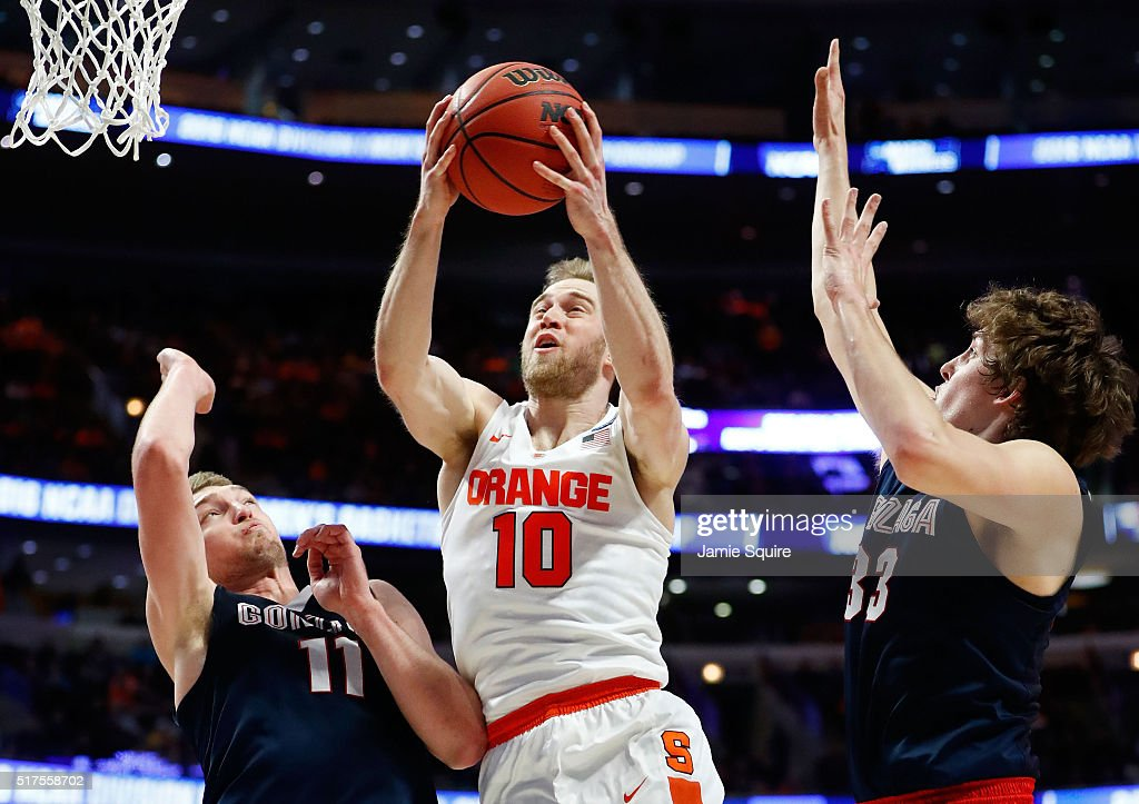 Trevor Cooney #10 of the Syracuse Orange shoots against Domantas Sabonis #11 and Kyle Wiltjer #33 of the Gonzaga Bulldogs in the first half during the 2016 NCAA Men's Basketball Tournament Midwest Regional at United Center on March 25, 2016 in Chicago, Illinois.
