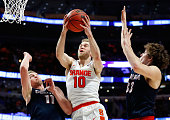 Trevor Cooney of the Syracuse Orange shoots against Domantas Sabonis and Kyle Wiltjer of the Gonzaga Bulldogs in the first half during the 2016 NCAA...