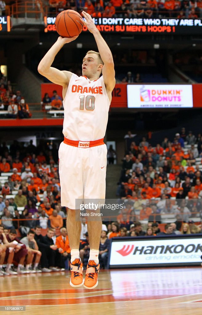 Trevor Cooney #10 of the Syracuse Orange shoots the ball during the game against the Colgate Raiders at the Carrier Dome on November 25, 2012 in Syracuse, New York.