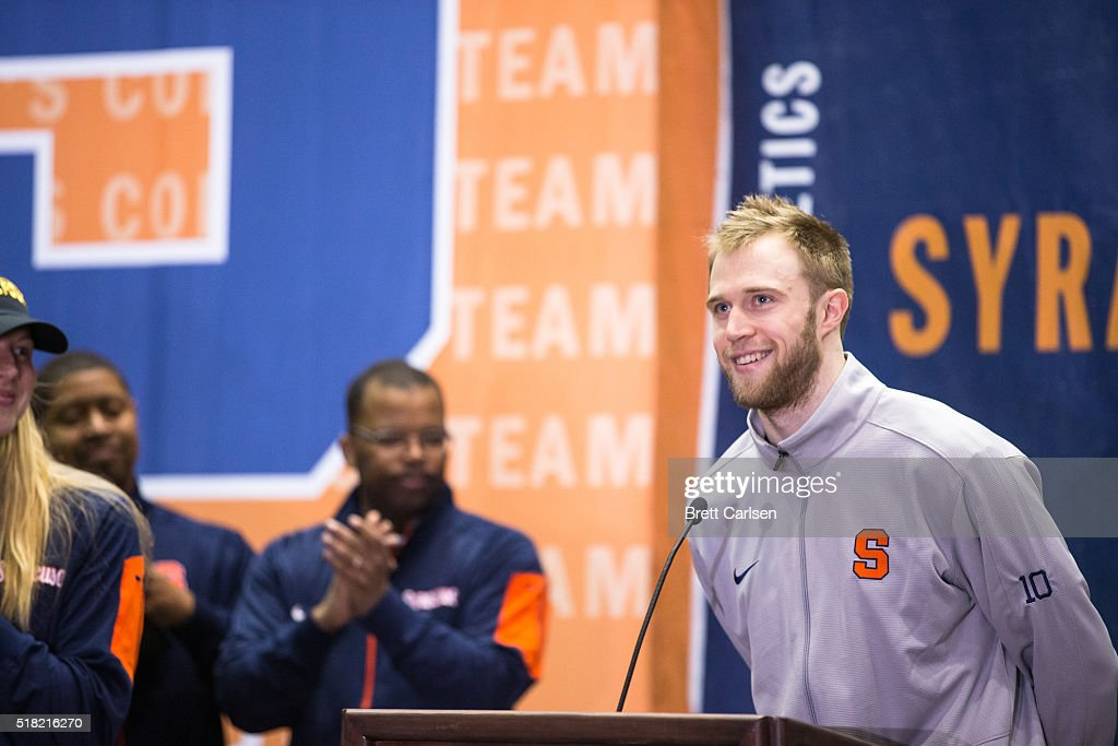 <a gi-track='captionPersonalityLinkClicked' href=/galleries/search?phrase=Trevor+Cooney&family=editorial&specificpeople=7117579 ng-click='$event.stopPropagation()'>Trevor Cooney</a> #10 of the Syracuse Orange speaks to fans at a pep rally celebrating the men's and women's Final Four basketball teams on March 30, 2016 at Manley Field House in Syracuse, New York.