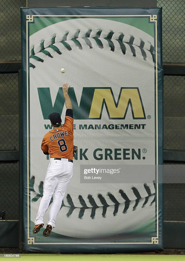 <a gi-track='captionPersonalityLinkClicked' href=/galleries/search?phrase=Trevor+Crowe&family=editorial&specificpeople=836223 ng-click='$event.stopPropagation()'>Trevor Crowe</a> #8 of the Houston Astros leaps but can't make a play on the ball off the left field wall off the bat of Erick Aybar (not pictured) of the Los Angeles Angels of Anaheim at Minute Maid Park on September 13, 2013 in Houston, Texas.