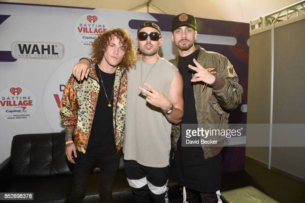 Trevor Dahl Matthew Russell and KEVI of Cheat Codes backstage during the Daytime Village Presented by Capital One at the 2017 HeartRadio Music...