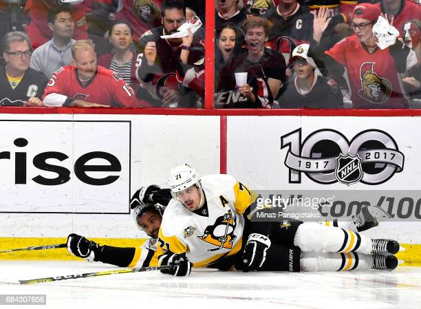 Trevor Daley and Evgeni Malkin of the Pittsburgh Penguins fall to the ice against Ottawa Senators during the second period in Game Three of the...