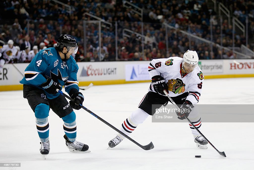 Trevor Daley #6 of the Chicago Blackhawks controls the puck in front of Brenden Dillon #4 of the San Jose Sharks at SAP Center on November 25, 2015 in San Jose, California.
