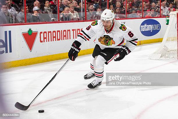 Trevor Daley of the Chicago Blackhawks corals the puck against the Ottawa Senators during an NHL game at Canadian Tire Centre on December 3 2015 in...