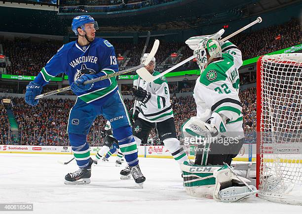 Trevor Daley of the Dallas Stars watches Kari Lehtonen of the Stars bat the puck away from Nick Bonino of the Vancouver Canucks during their NHL game...