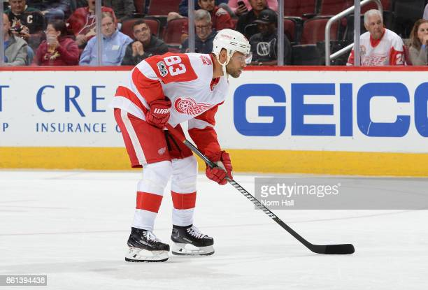 Trevor Daley of the Detroit Red Wings gets ready during a faceoff against the Arizona Coyotes at Gila River Arena on October 12 2017 in Glendale...