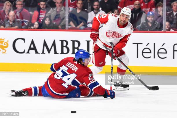 Trevor Daley of the Detroit Red Wings plays the puck past Charles Hudon of the Montreal Canadiens during the NHL game at the Bell Centre on December...