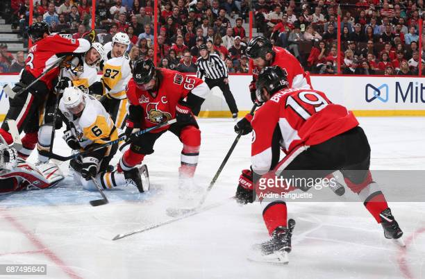 Trevor Daley of the Pittsburgh Penguins battles for a loose puck with Erik Karlsson Zack Smith and Derick Brassard of the Ottawa Senators in Game Six...