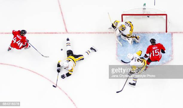 Trevor Daley of the Pittsburgh Penguins blocks a shot by JeanGabriel Pageau of the Ottawa Senators as Olli Maatta and MarcAndre Fleury of the...