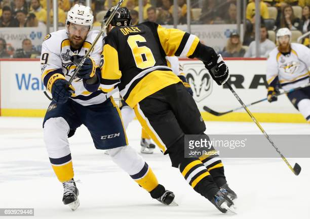 Trevor Daley of the Pittsburgh Penguins checks Roman Josi of the Nashville Predators during the first period of Game Five of the 2017 NHL Stanley Cup...
