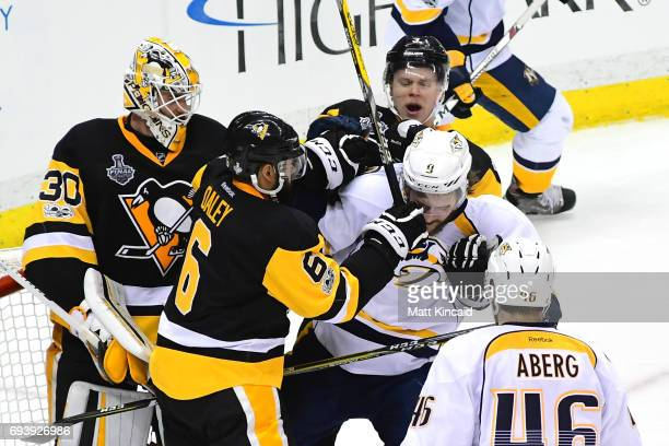 Trevor Daley of the Pittsburgh Penguins collides with Filip Forsberg of the Nashville Predators in front of goalie Matt Murray in the second period...
