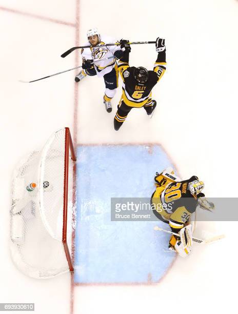 Trevor Daley of the Pittsburgh Penguins collides with Pontus Aberg of the Nashville Predators in the third period in Game Five of the 2017 NHL...