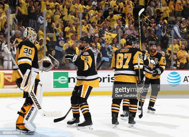 Trevor Daley of the Pittsburgh Penguins congratulates goaltender Matt Murray after their 53 win over the Nashville Predators in Game One of the 2017...