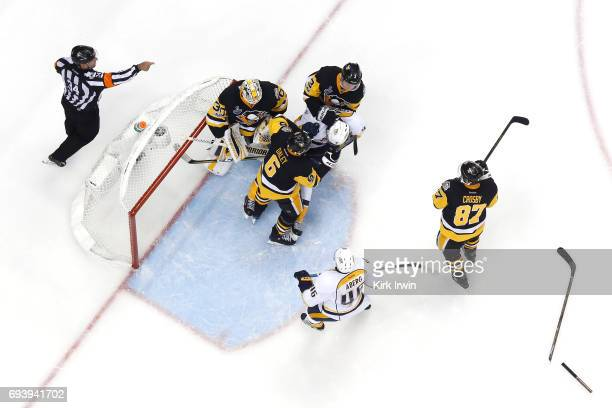 Trevor Daley of the Pittsburgh Penguins gets tangled with Filip Forsberg of the Nashville Predators in front of goalie Matt Murray in the second...