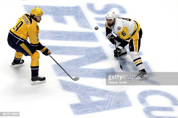 Trevor Daley of the Pittsburgh Penguins is defended by Filip Forsberg of the Nashville Predators during the first period in Game Six of the 2017 NHL...
