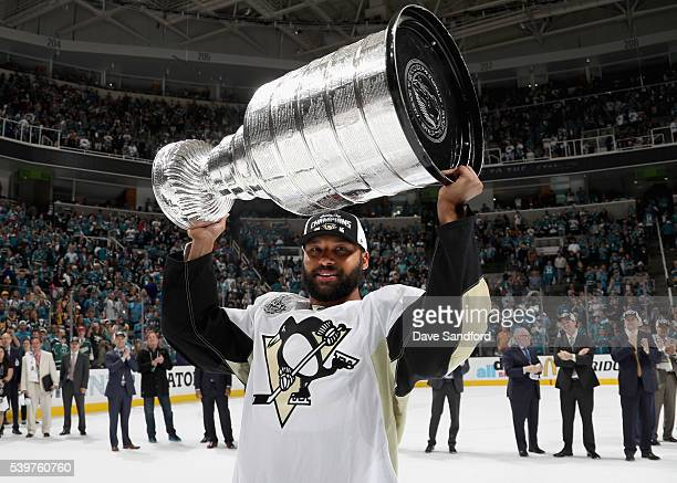 Trevor Daley of the Pittsburgh Penguins lifts the Stanley Cup after his team won Game 6 of the 2016 NHL Stanley Cup Final over the San Jose Sharks at...