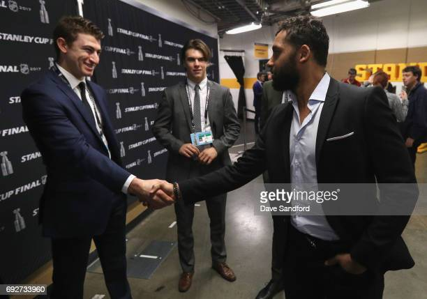 Trevor Daley of the Pittsburgh Penguins shakes hands with top prospects Nico Hischier and Gabriel Vilardi during media availability for 2017 NHL...