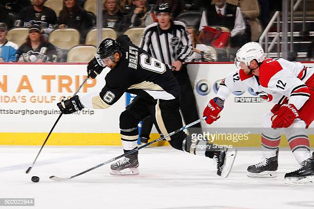 Trevor Daley of the Pittsburgh Penguins takes a shot in front of Eric Staal of the Carolina Hurricanes at Consol Energy Center on December 19 2015 in...