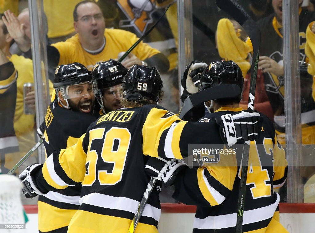 Trevor Daley #6, Sidney Crosby #87, Jake Guentzel #59 of the Pittsburgh Penguins celebrate with teammate Conor Sheary #43 after his goal during the second period of Game Five of the 2017 NHL Stanley Cup Final against the Nashville Predators at PPG Paints Arena on June 8, 2017 in Pittsburgh, Pennslyvannia.