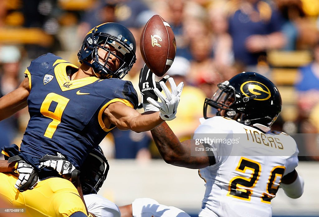 Trevor Davis of the California Golden Bears can not hold on to the ball while covered by Guy Stallworth of the Grambling State Tigers at California...