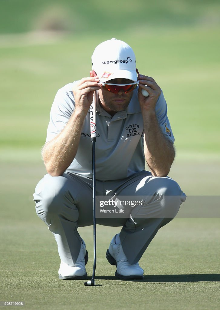 Trevor Fisher Jnr of South Africa lines up a putt on the 10th green during the third round of the Omega Dubai Desert Classic at the Emirates Golf Club on February 6, 2016 in Dubai, United Arab Emirates.