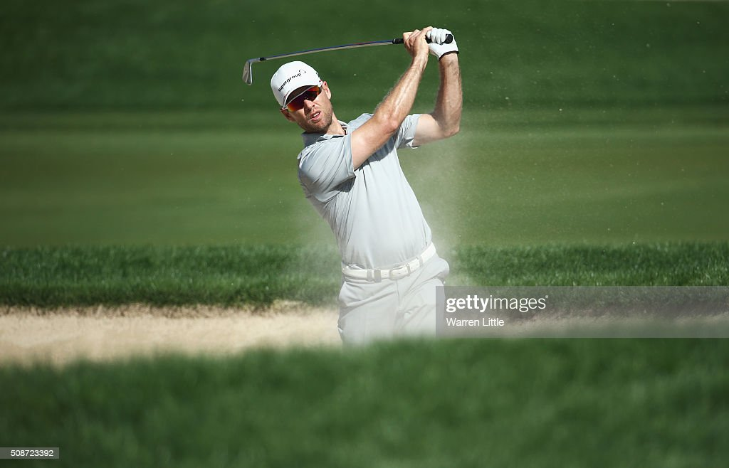 Trevor Fisher Jnr of South Africa plays from a bunker on the 9th hole during the third round of the Omega Dubai Desert Classic at the Emirates Golf Club on February 6, 2016 in Dubai, United Arab Emirates.