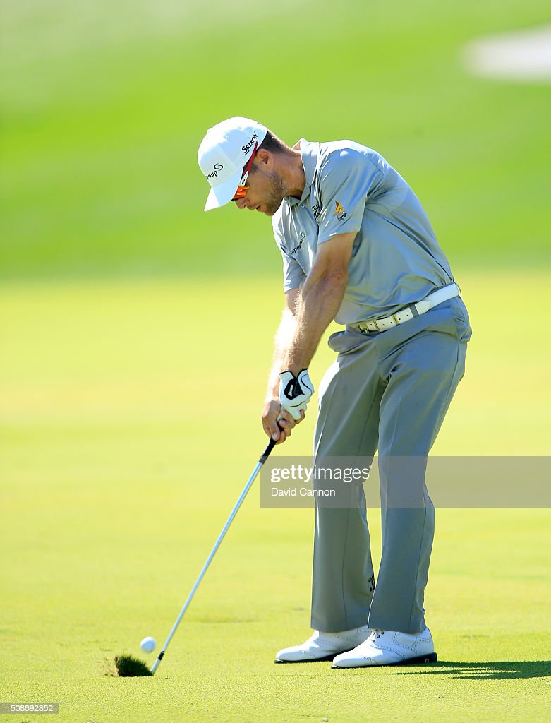 Trevor Fisher Jnr of South Africa plays his second shot at the par 4, first hole during the third round of the 2016 Omega Dubai Desert Classic on the Majlis Course at the Emirates Golf Club on February 6, 2016 in Dubai, United Arab Emirates.