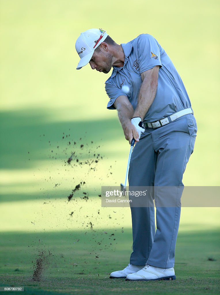 Trevor Fisher Jnr of South Africa plays his second shot at the par 4, 14th hole during the third round of the 2016 Omega Dubai Desert Classic on the Majlis Course at the Emirates Golf Club on February 6, 2016 in Dubai, United Arab Emirates.