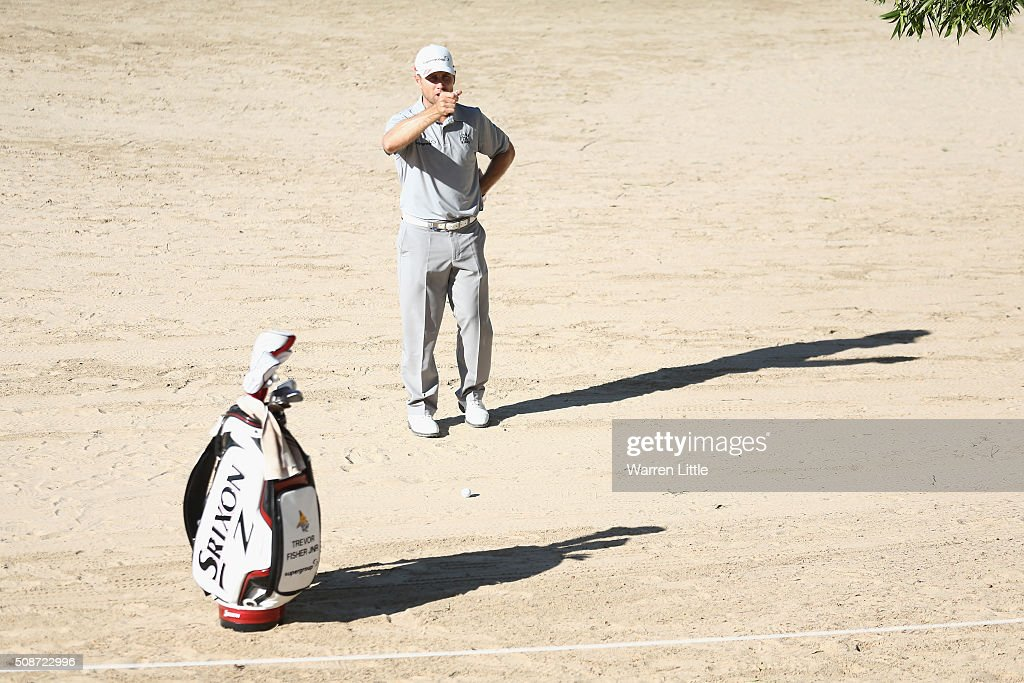 Trevor Fisher Jnr of South Africa prepares to play his second shot on the 13th hole during the third round of the Omega Dubai Desert Classic at the Emirates Golf Club on February 6, 2016 in Dubai, United Arab Emirates.