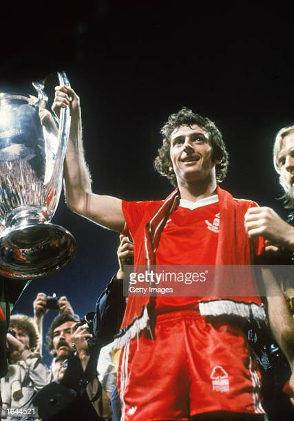 Trevor Francis of Nottingham Forest celebrates scoring the winning goal by lifting the cup after the European Cup Final between Nottingham Forest and...