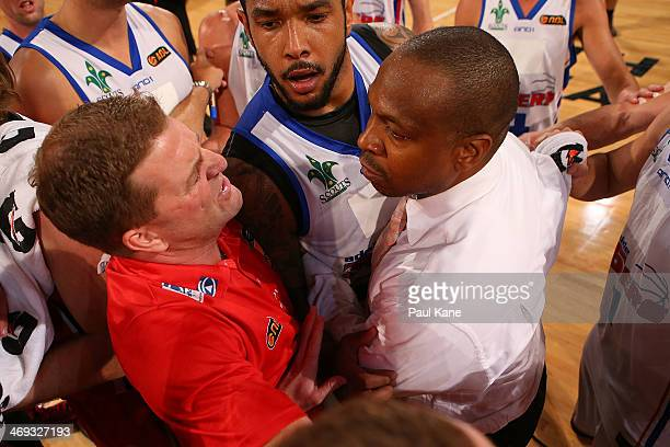 Trevor Gleeson coach of the Wildcats and Joey Wright coach of the 36ers exchange words after the round 18 NBL match between the Perth Wildcats and...