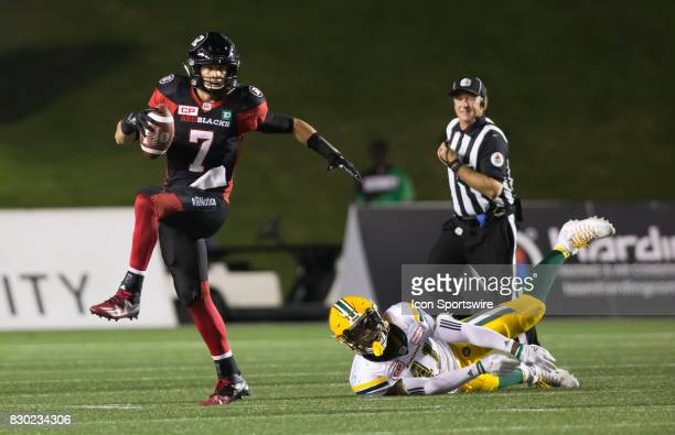 Trevor Harris of the Ottawa Redblacks evades the Edmonton Eskimos sack attempt in Canadian Football League action at TD Place in Ottawa Canada on 10...