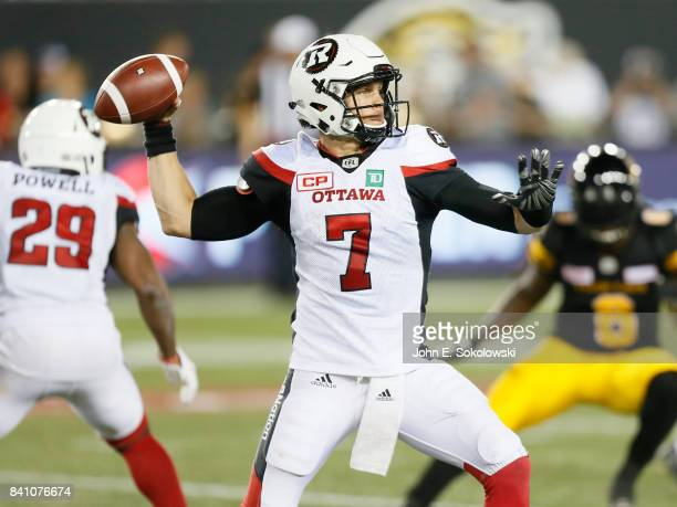 Trevor Harris of the Ottawa Redblacks goes to throw a pass against the Hamilton TigerCats during a CFL game at Tim Hortons Field on August 18 2017 in...